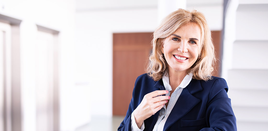An empowered mature woman in a suit