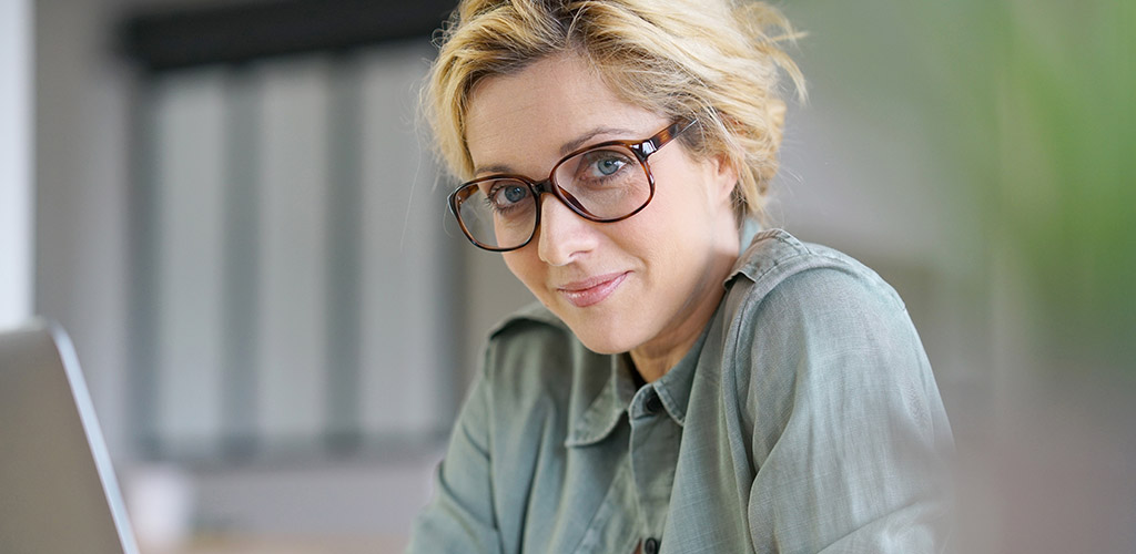 A beautiful mature woman in glasses