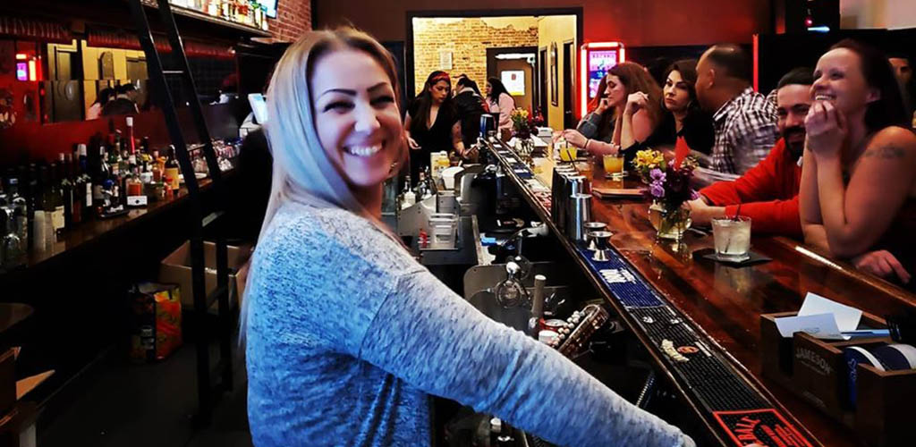 A beautiful woman managing the bar at Deliberation Room