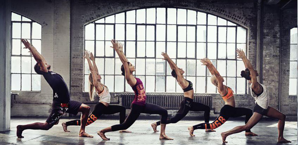 Mature women in a yoga pose at Gold's Gym