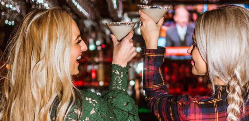 Lexington MILFs toasting cocktails at a bar in The Merrick Inn