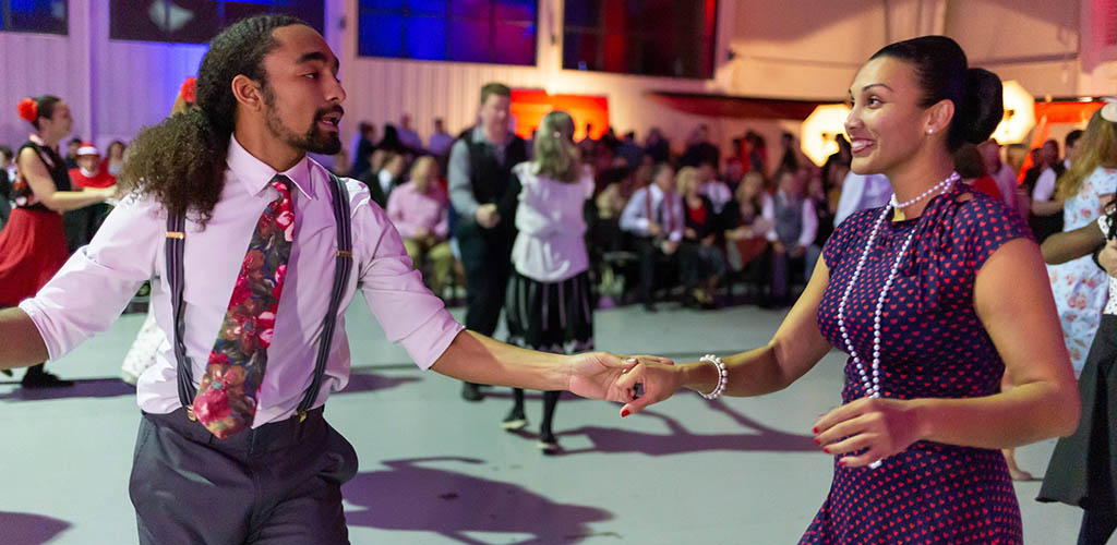 A couple dancing during an event at the Military Aviation Museum