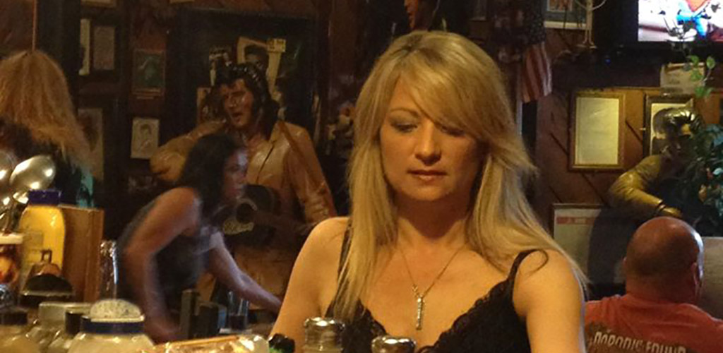 A sultry blonde drinking at Poppa's Pub & Restaurant