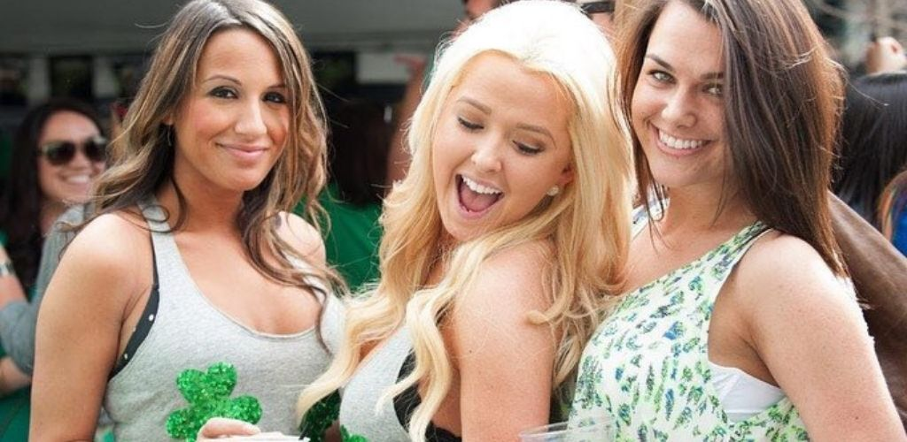 Hot Philadelphia cougars celebrating St Patrick's Day with drinks in Liberty Bar & Grill