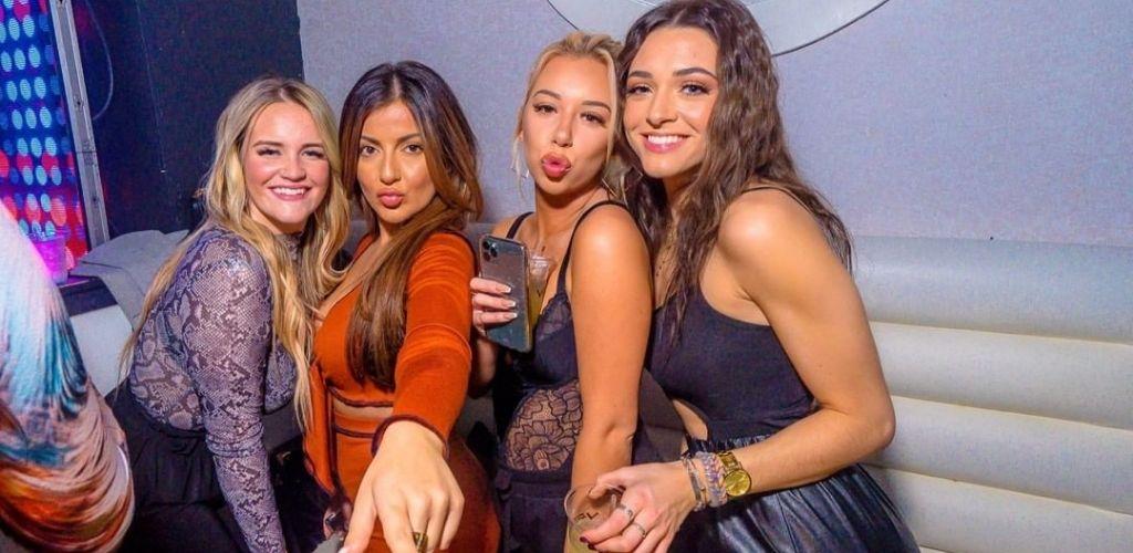 Young Boston cougars taking a group selfie at Venu Boston Nightclub