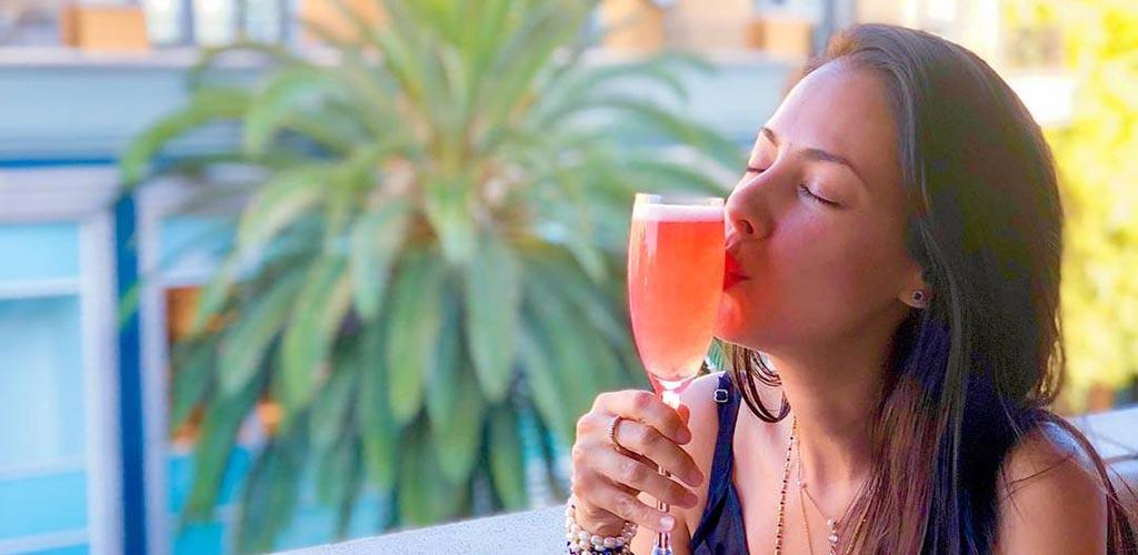 A woman enjoying her drink at VBar