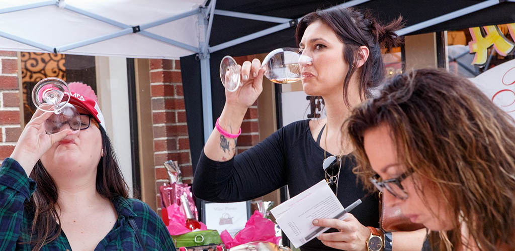Friends drinking wine at Ybor City Wine Bar