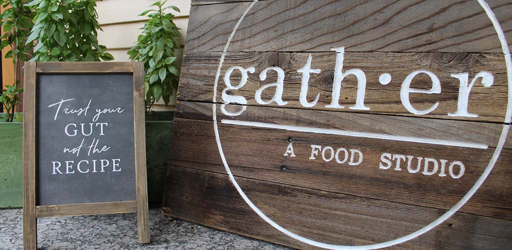 The cute rustic sign of Gather Food Studio