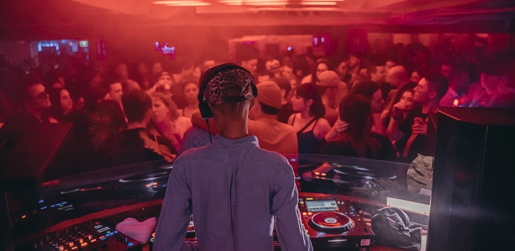 The DJ playing music at Hide and Seek / Taboo Night Club
