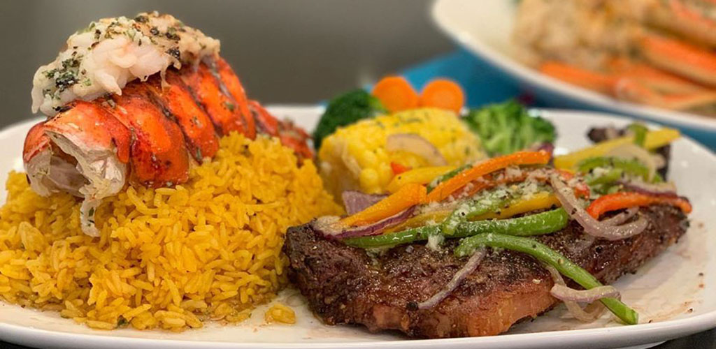 A delicious lobster tail and steak from South Beach Grill