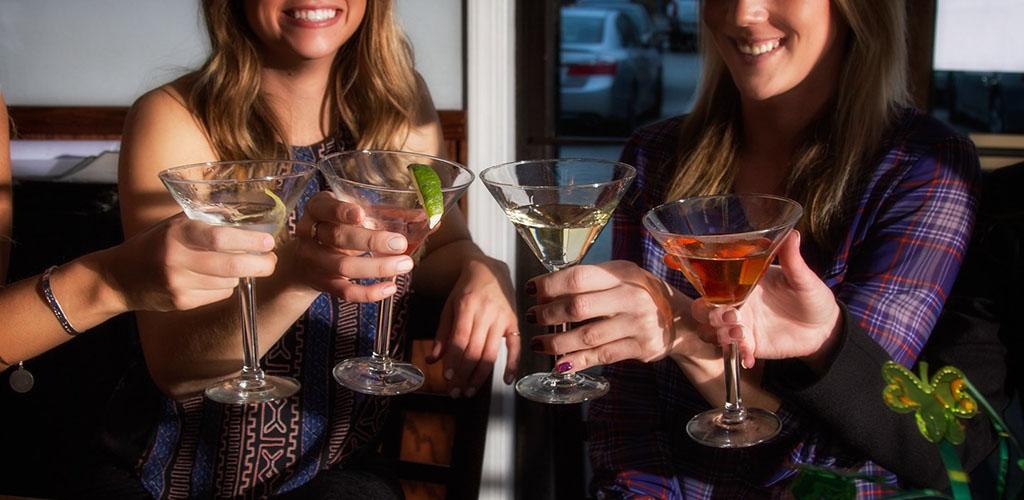 Ladies toasting cocktails at Tempt Restaurant Lounge