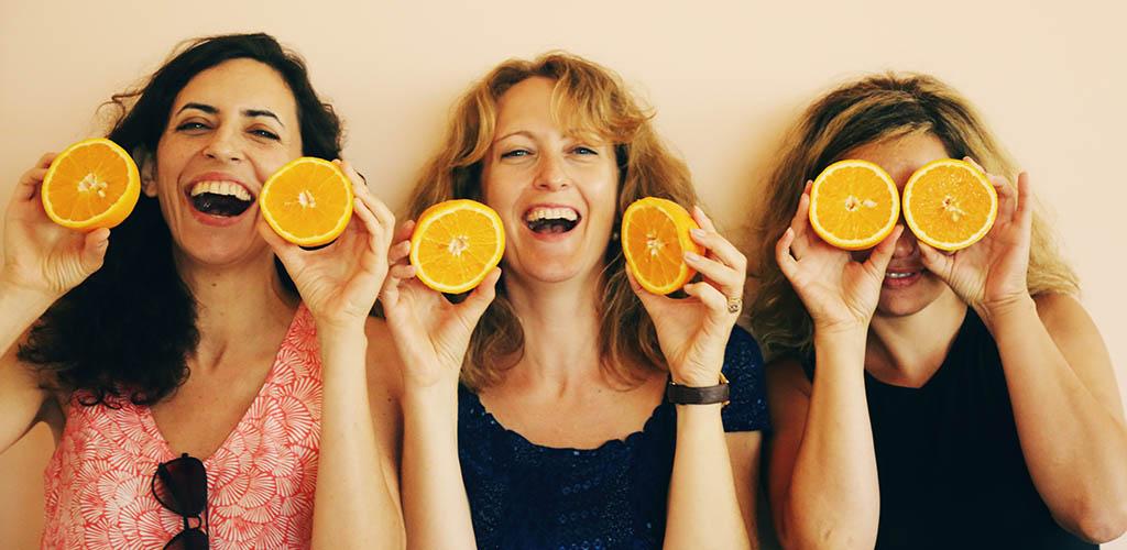 Beautiful cougars in Jacksonville Florida having fun with oranges