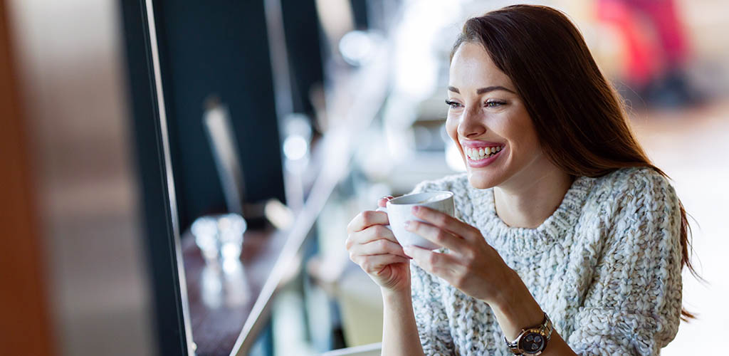 A woman enjoying some me-time in a coffee shop