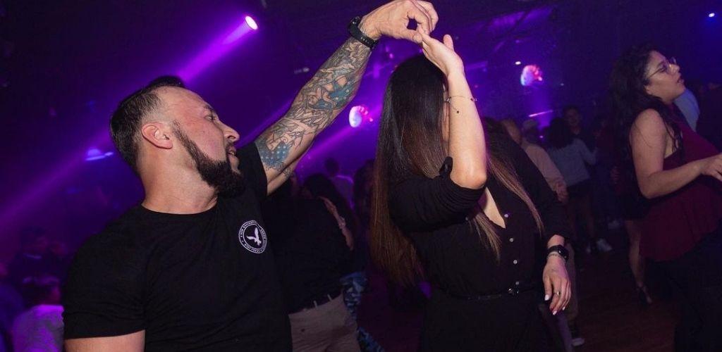Omaha MILF dancing with a man at Rhythmz Lounge