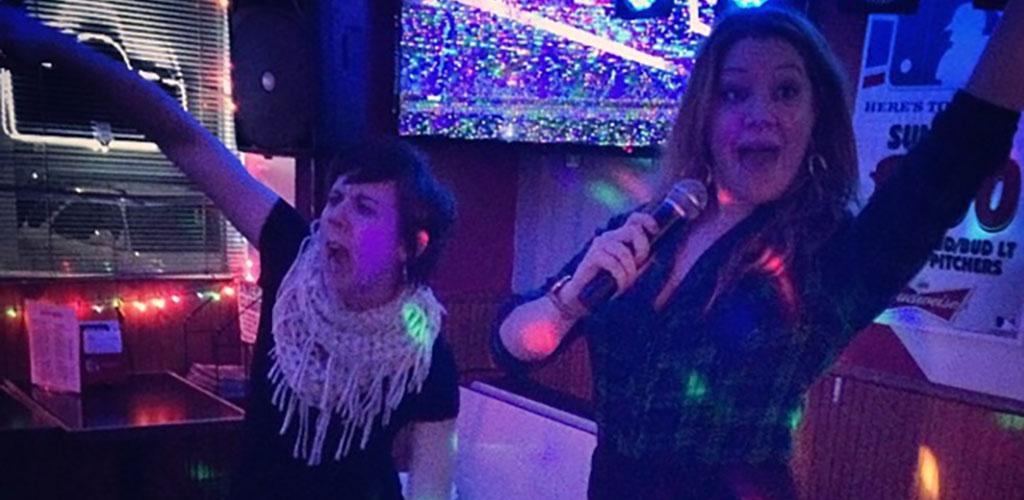 Ladies singing karaoke at Bob's MVP Lounge