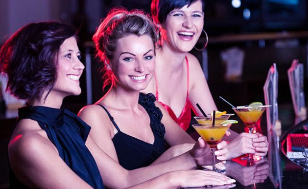 Happy, smiling women at a bar