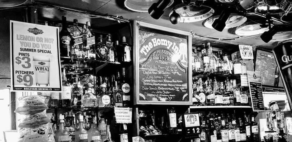 The fully stocked bar at Homy Inn