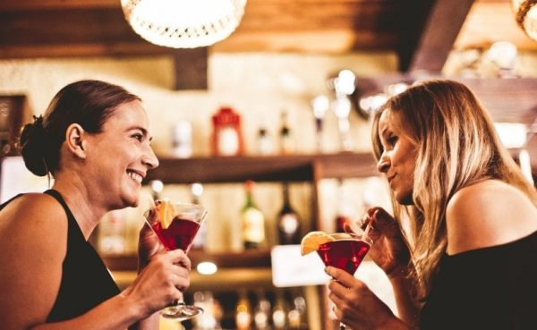 Dallas MILFs sitting by the bar and drinking cocktails