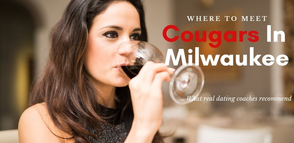 A beautiful cougar in Milwaukee sipping red wine in a bar