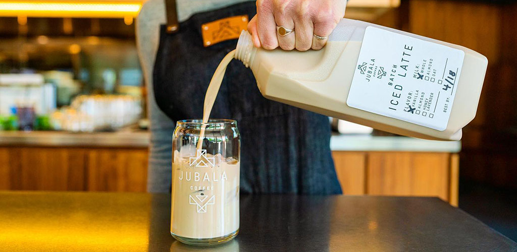 Pouring an iced latte at Jubala Coffee