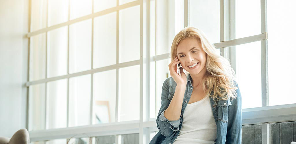A beautiful woman talking on the phone