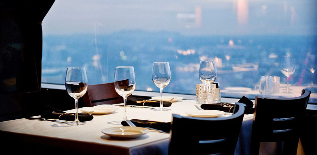 A table with a view of the city at Portland City Grill