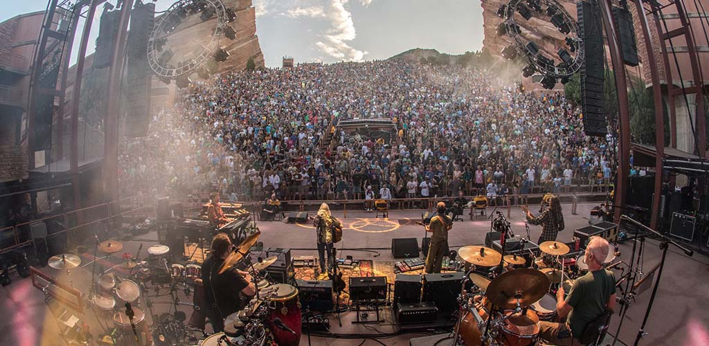 The huge crowd watching a rock band at Red Rocks Park and Amphitheatre