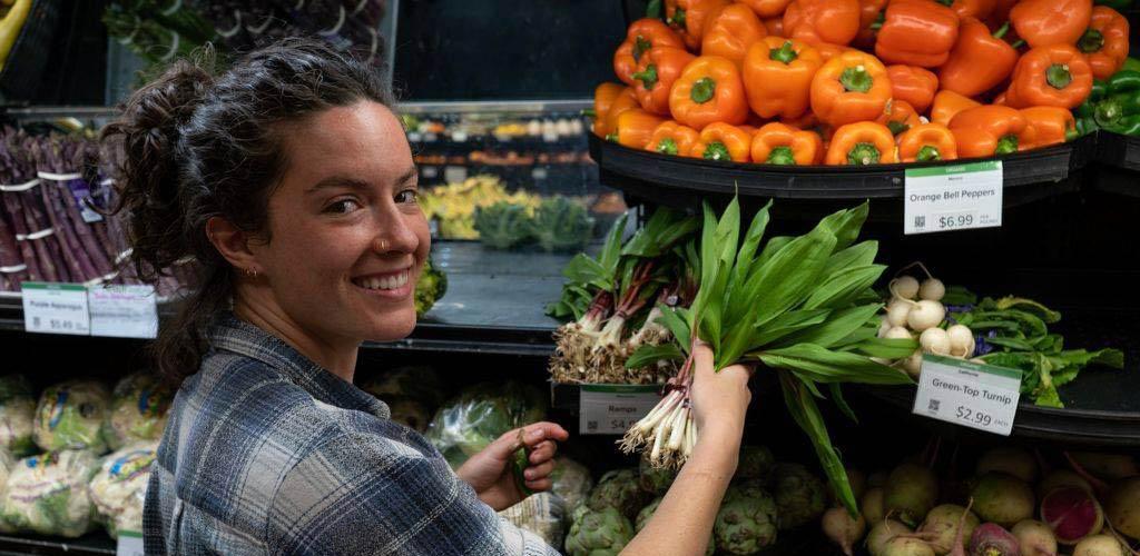 Buying fresh produce at Seward Community Co-op