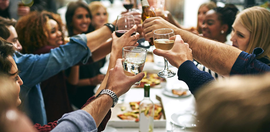 Friends having dinner and drinks at Sullivan's Steakhouse