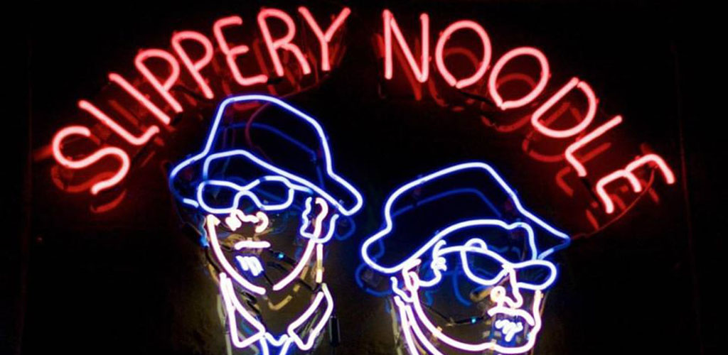 The neon sign of Slippery Noodle
