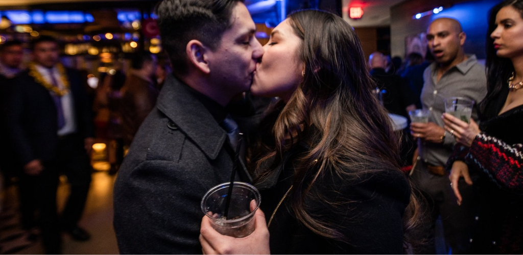 El Paso MILF holding a drink and kissing her date at Circa 1963