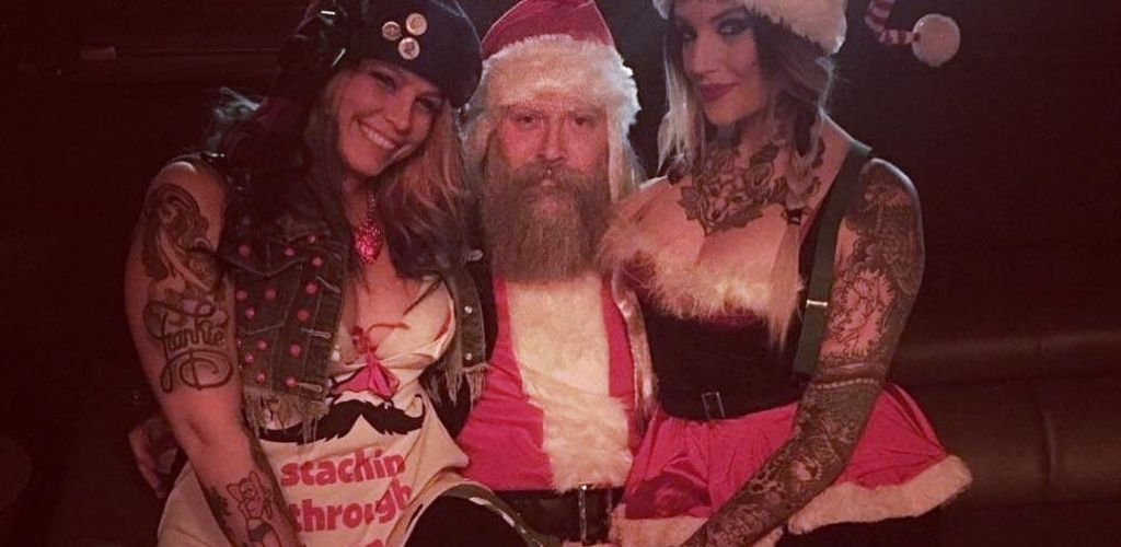 2 Detroit cougars with Santa at a costume party in Delux Bar & Lounge