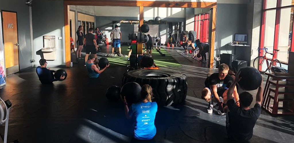 Men and women working out at Urban Fitness Gym