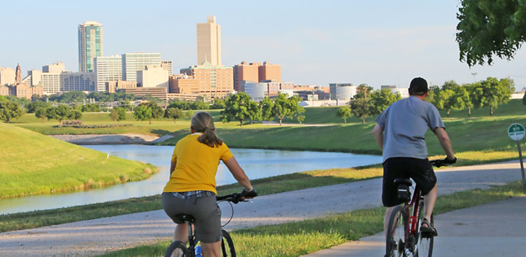 couple riding bikes at Trinity Park