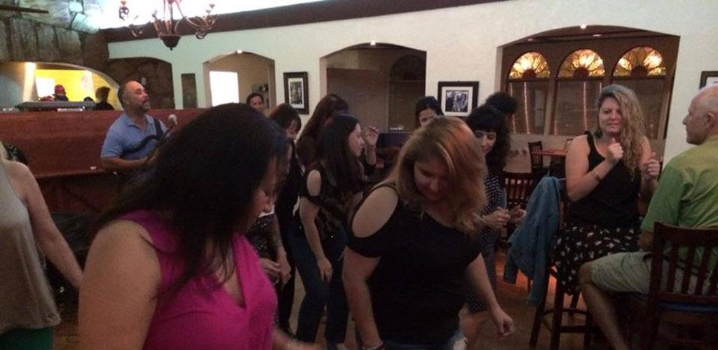 Ladies dancing at Il Vinaio