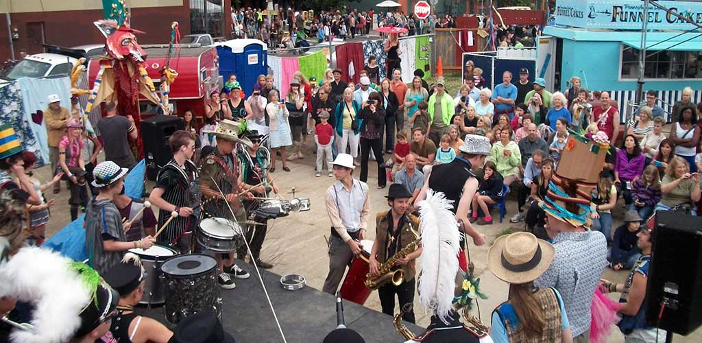 People gathered for a quirky live performance at the Alberta District Art Walks