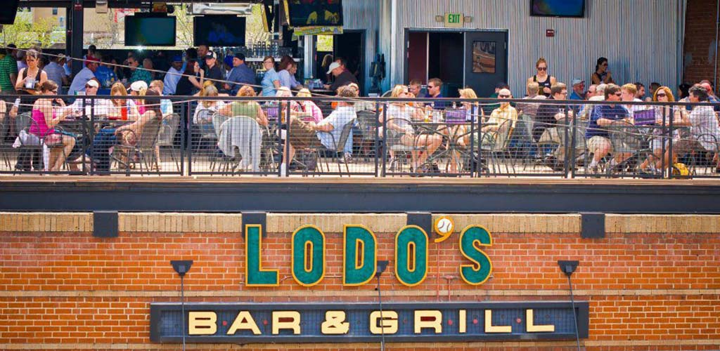 Cougars in Denver enjoying daytime drinks at the rooftop of Lodo's Bar & Grill
