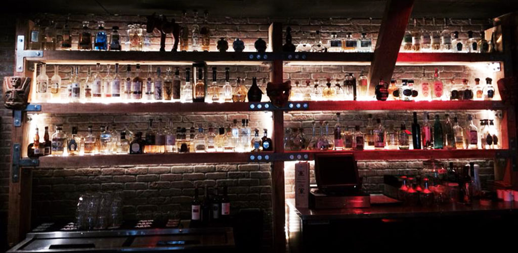 The well-lit bar at Machete Tequila
