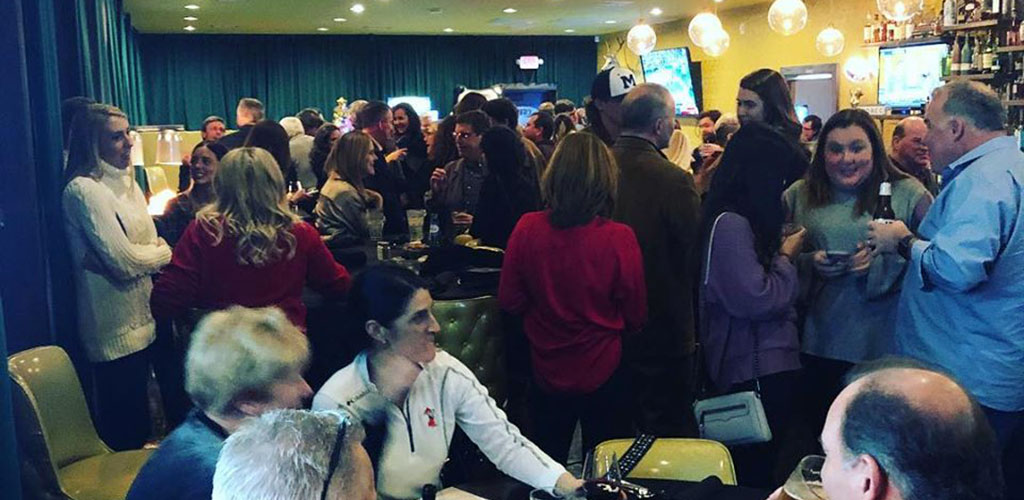 A big crowd of people at Ned's Starlite Lounge