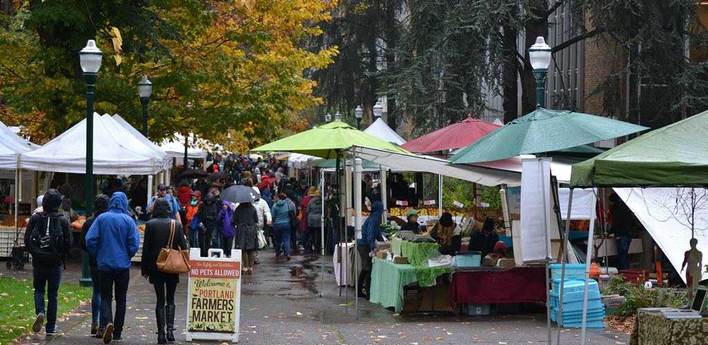 Crowds of people gathering at the Farmers Market