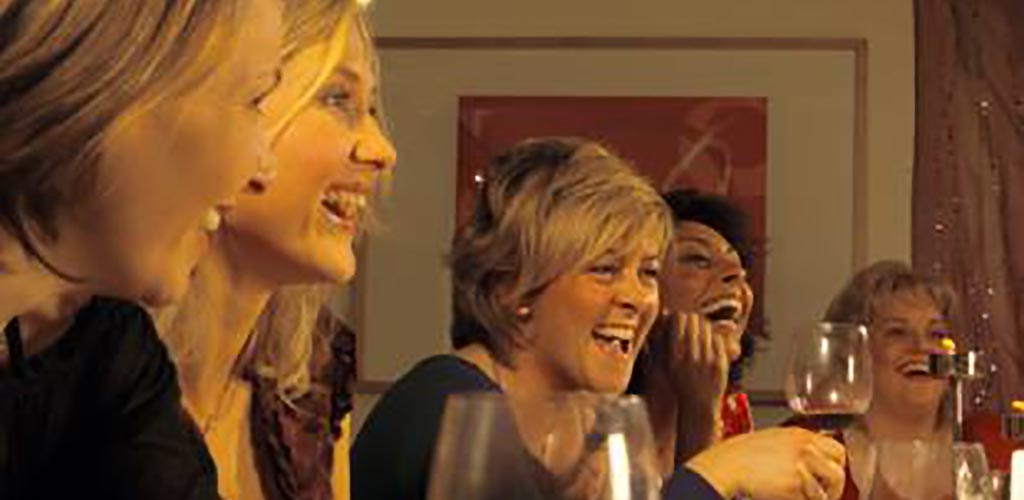 Mature women drinking at Red Sky