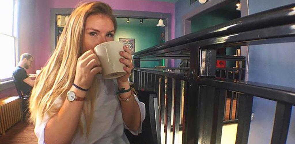 Woman drinking coffee at Rochambo Coffee and Tea House