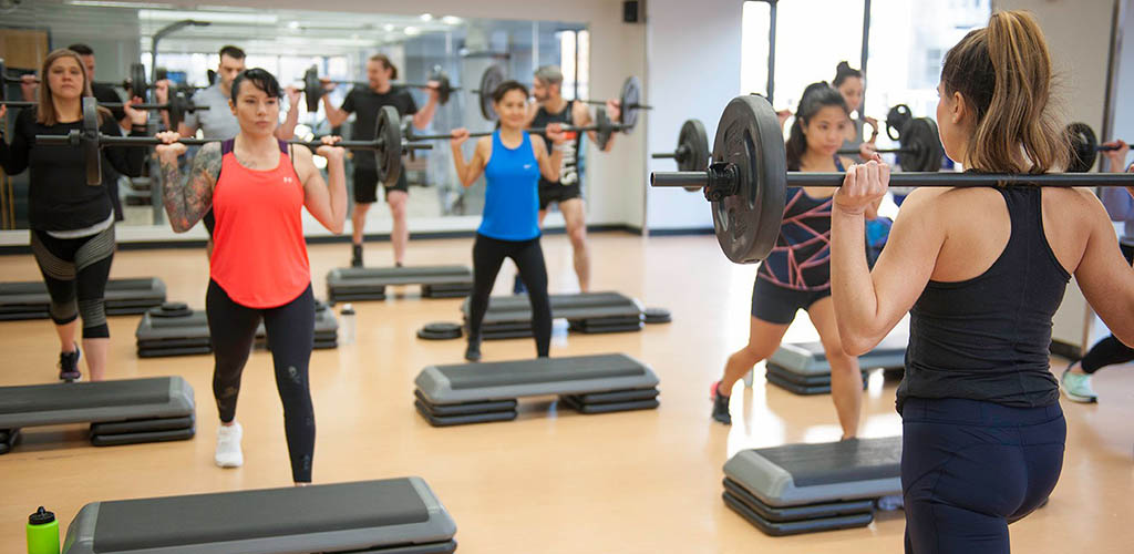 Women lifting weights at Town Place Fitness