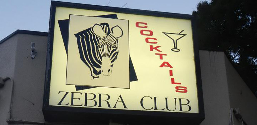 The signage Zebra Club