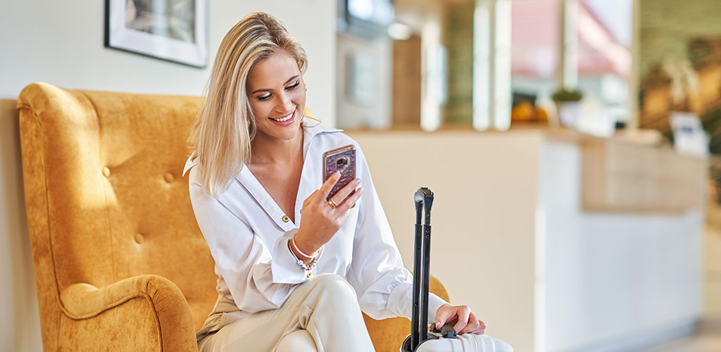 A beautiful woman on her phone in the lobby of a hotel