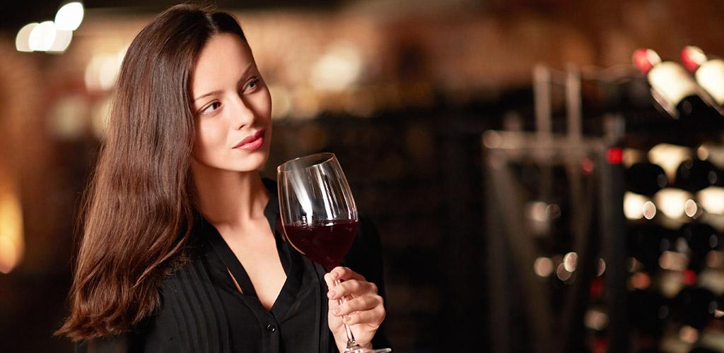 A woman sampling wines at a bar