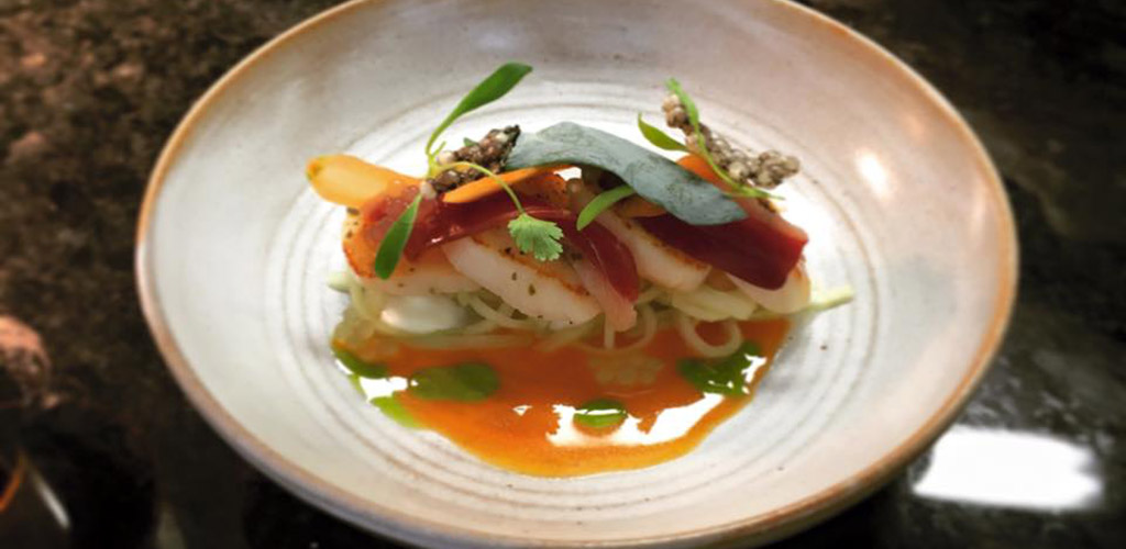 A scallop dish from The Cellar Restaurant