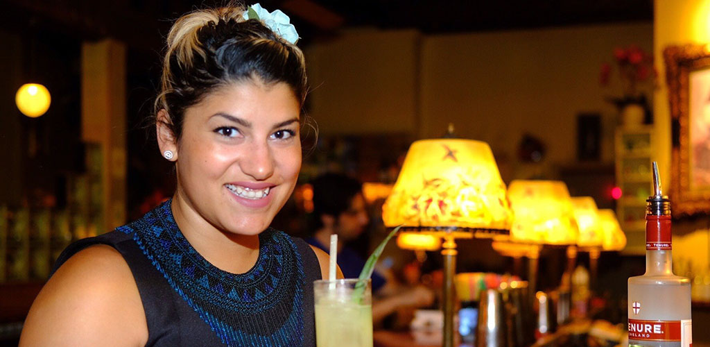 Woman at Cuchi Cuchi with a drink