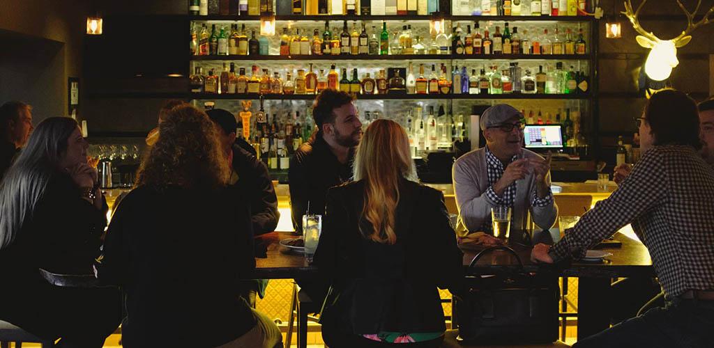 Friends having drinks at FLINT