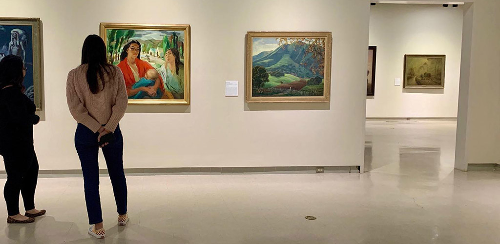 Women viewing artworks at the Fresno Art Museum